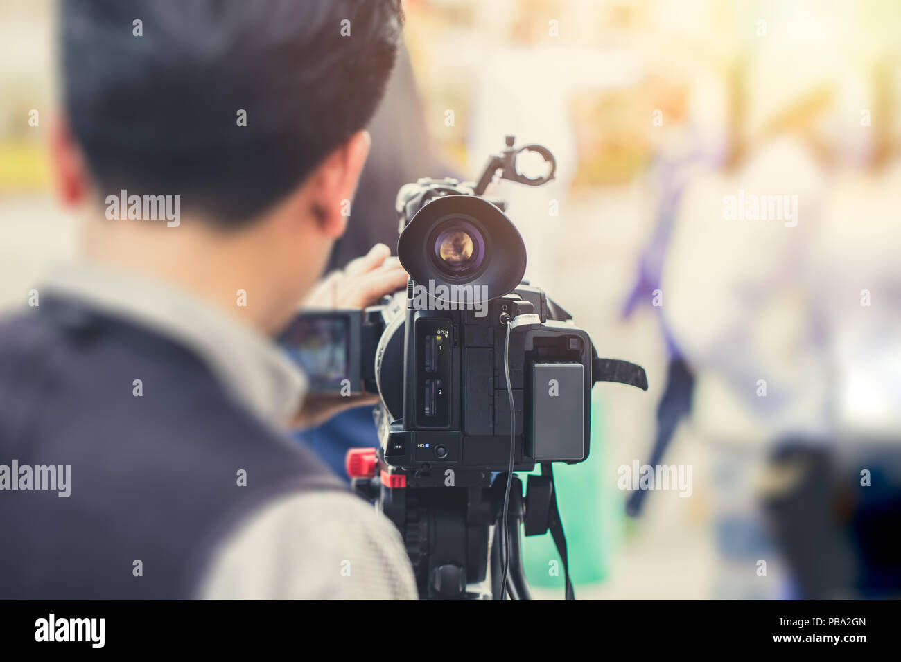 cameraman news report on duty vintage color tone - Stock Image