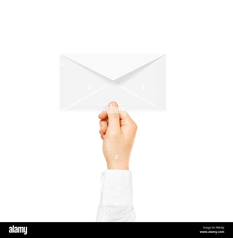White blank envelope mock up holding in hand. Empty post document ...