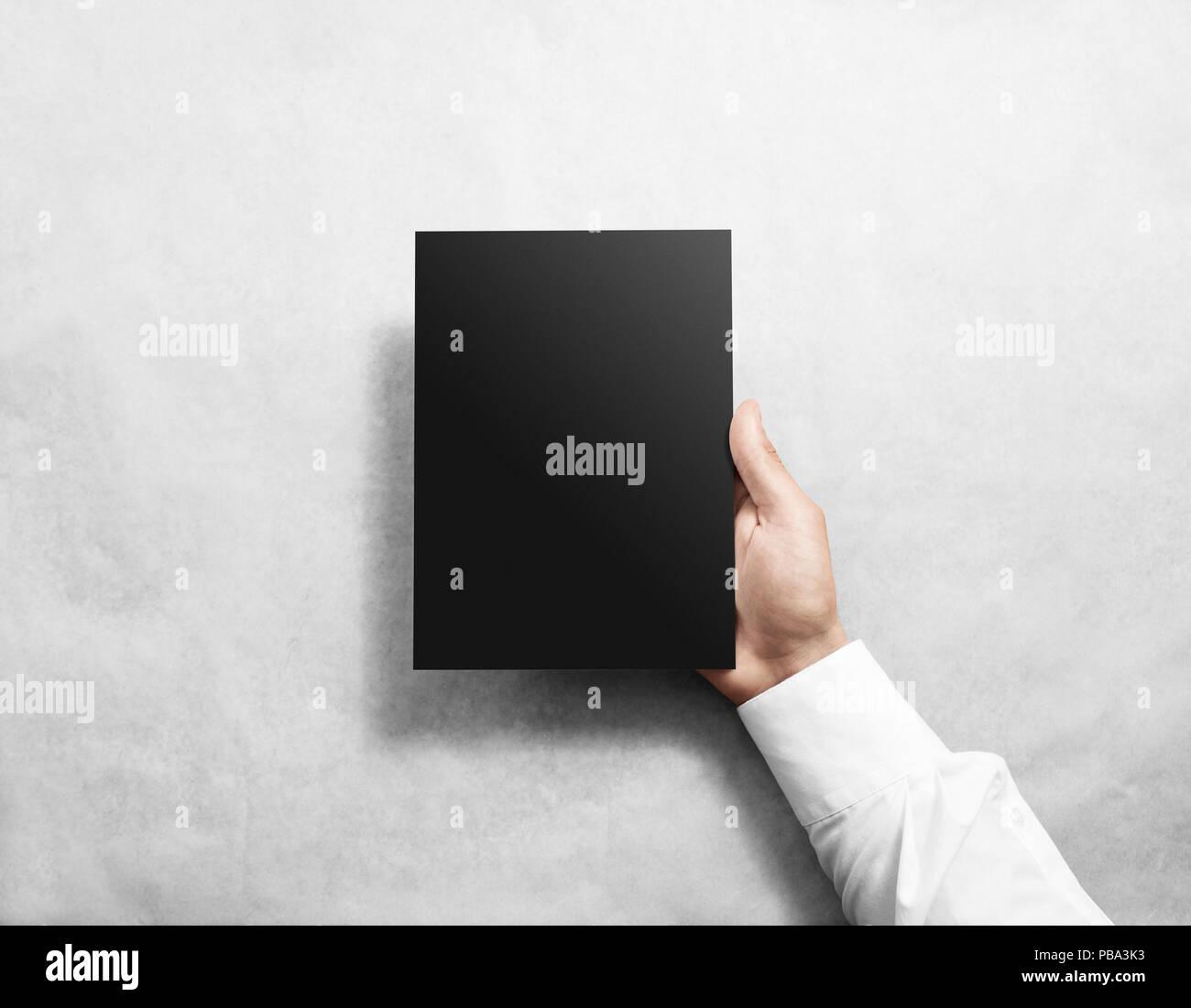 hand holding blank black brochure booklet mockup leaflet mock up