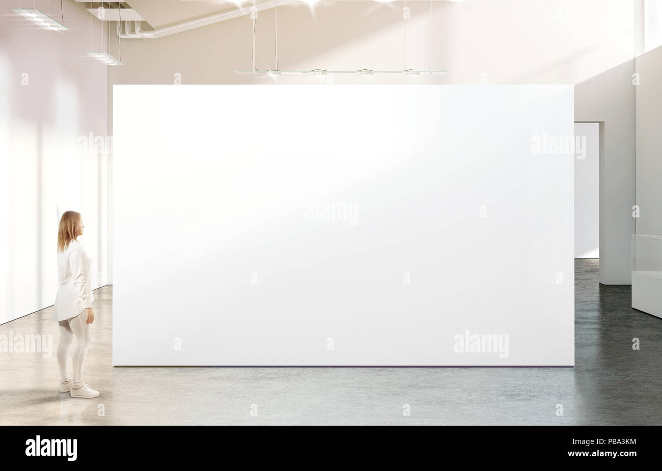 Woman walking near blank white wall mockup in modern gallery. Girl admires a clear big stand mock up in museum with contemporary art exhibitions. Larg Stock Photo