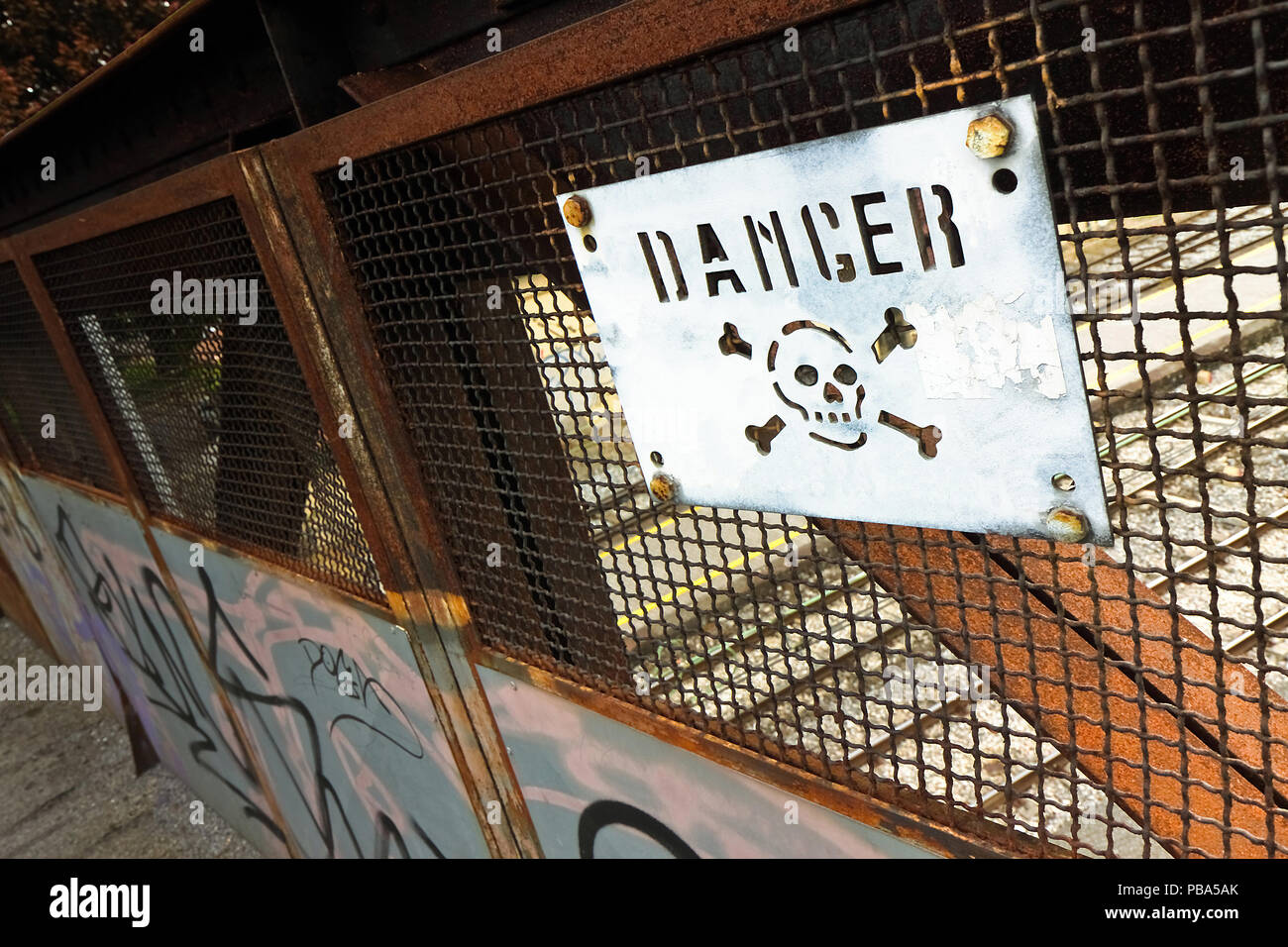 Road sign with the word danger on it - Stock Image