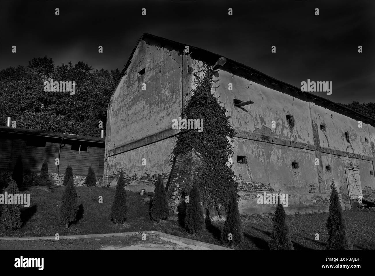 Old building and dark sky - Stock Image