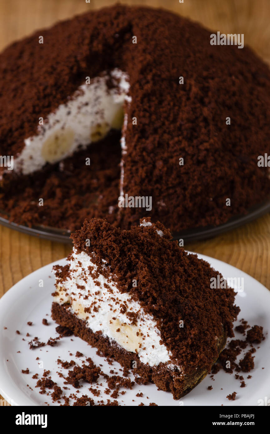 Smooth pie cake with banana and whiped cream - Stock Image
