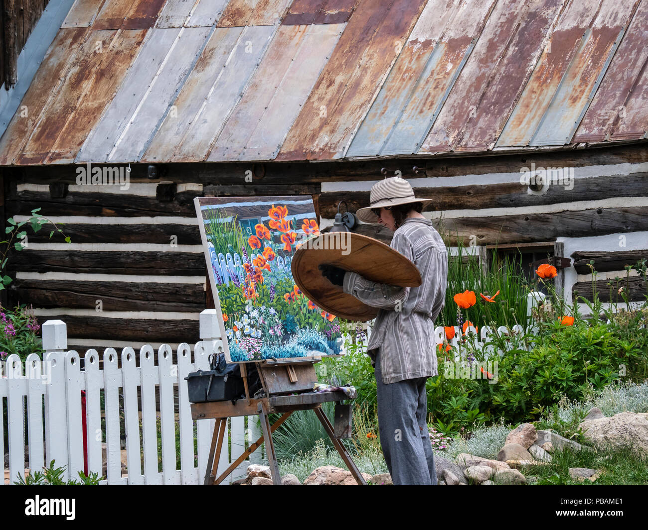 Painter on a back street, Crested Butte, Colorado. - Stock Image