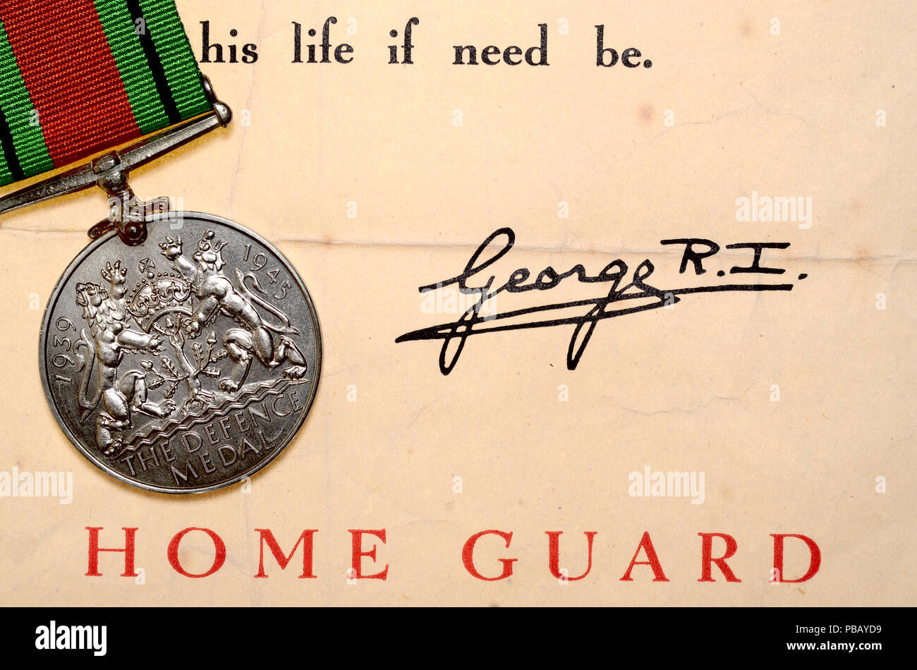British WW2 Defence Medal with a letter about service in the Home Guard - awarded to subjects of the British Commonwealth for both non-operational mil - Stock Image