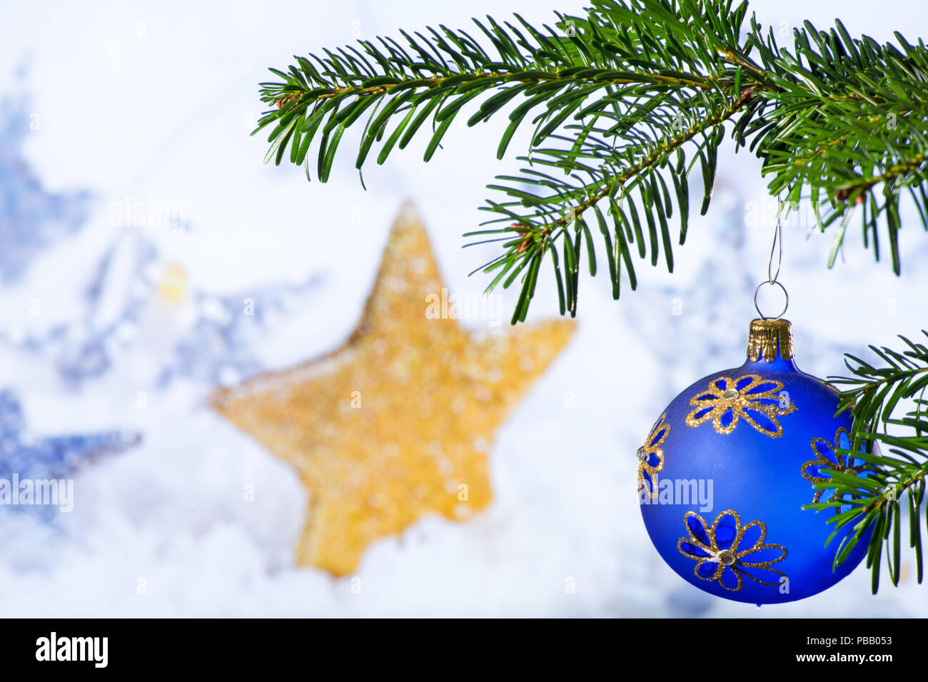 Blue Christmas Ball with Christmas Twig and Star - Stock Image