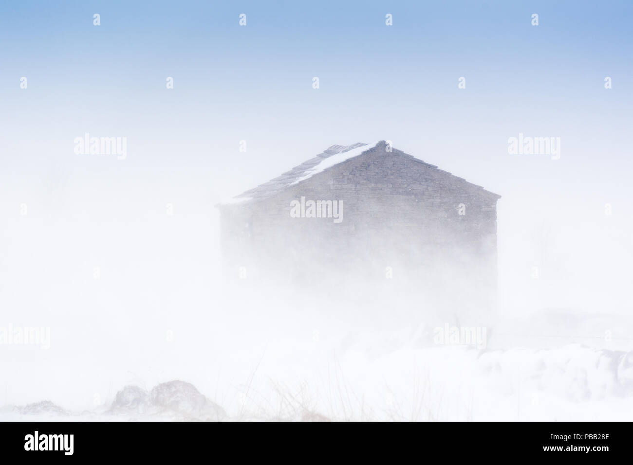 Stone barn in a snow storm, Mallerstang, in the Yorkshire, Dales, UK. Stock Photo
