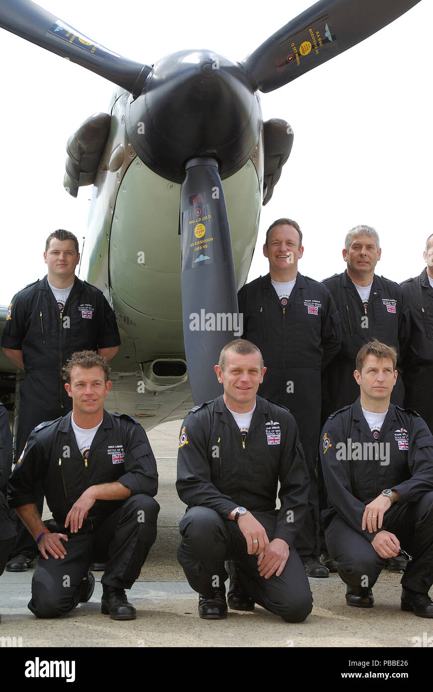 Royal Air Force RAF Battle of Britain Memorial Flight pilots and crew in front of a Second World War Supermarine Spitfire plane - Stock Image