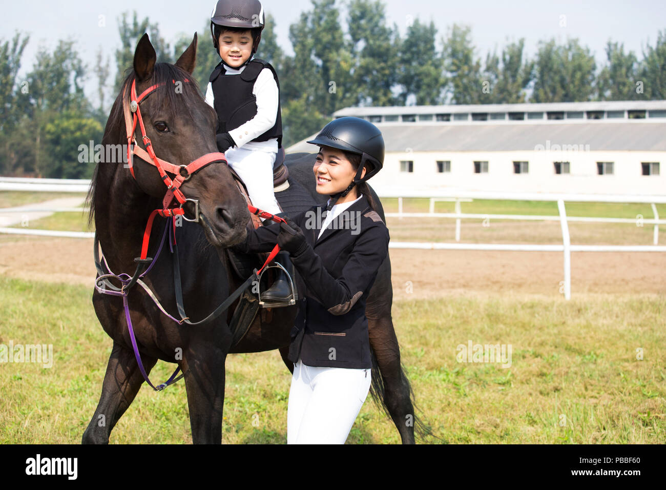 Mother And Daughter On Horseback High Resolution Stock Photography And Images Alamy