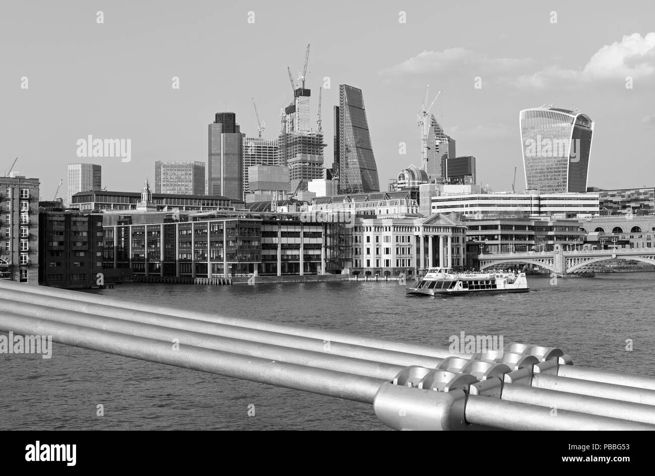 Views along the river Thames and the London city business district on a sunny April evening - Stock Image