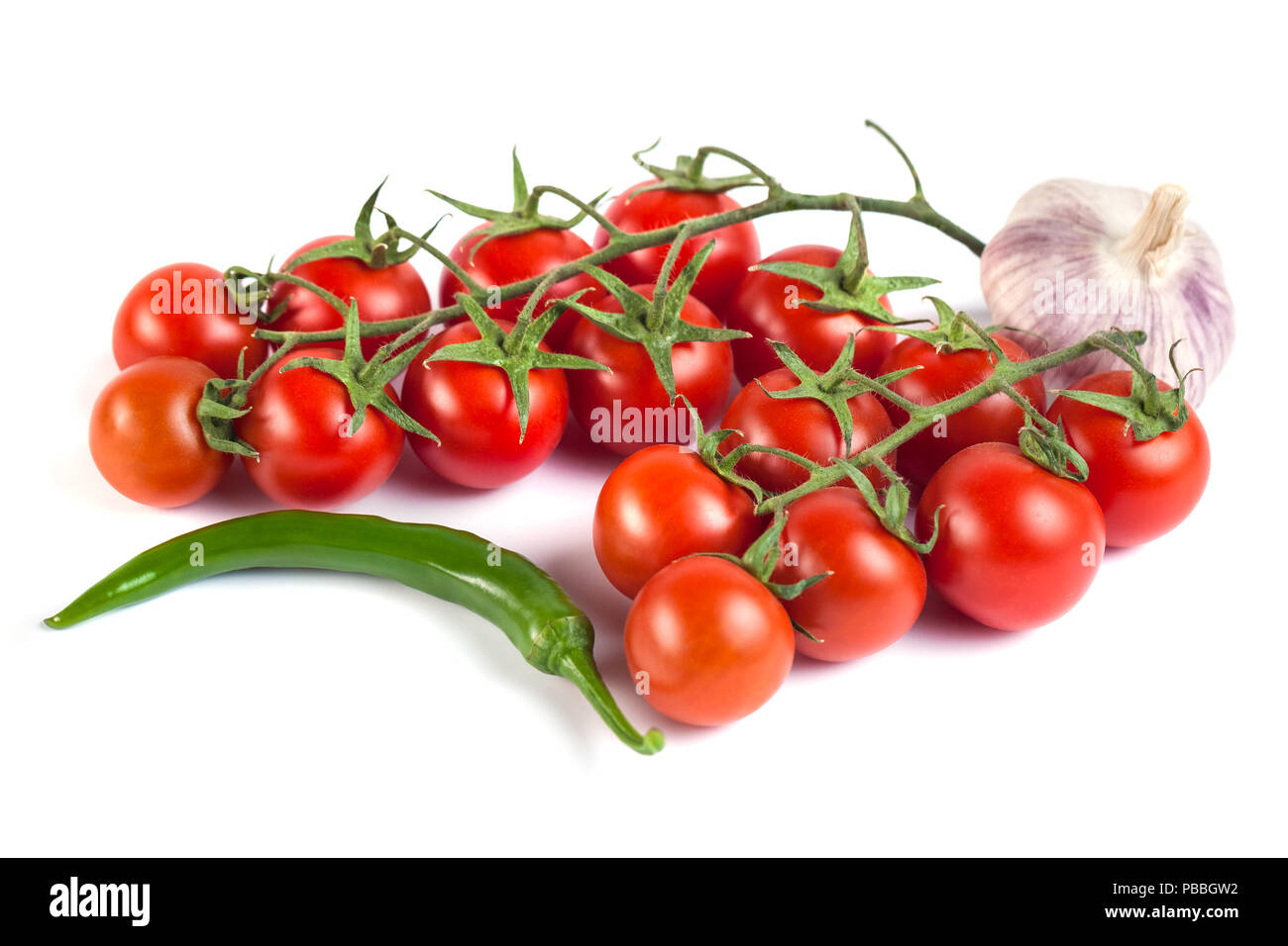 tomatoes, green peppers and other vegetables on a white background. - Stock Image