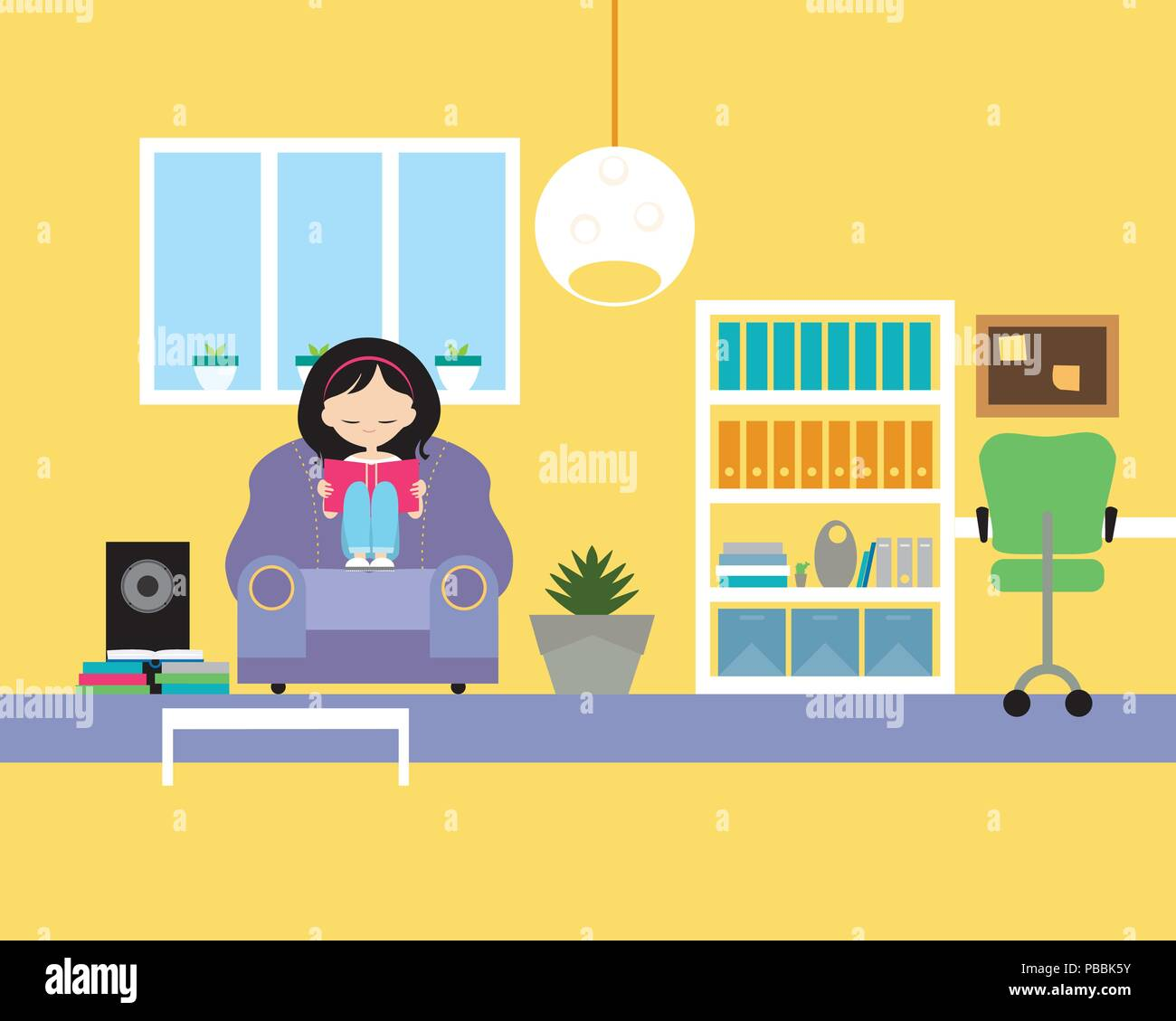 Young girl sitting on chair and reading book in living room with ...
