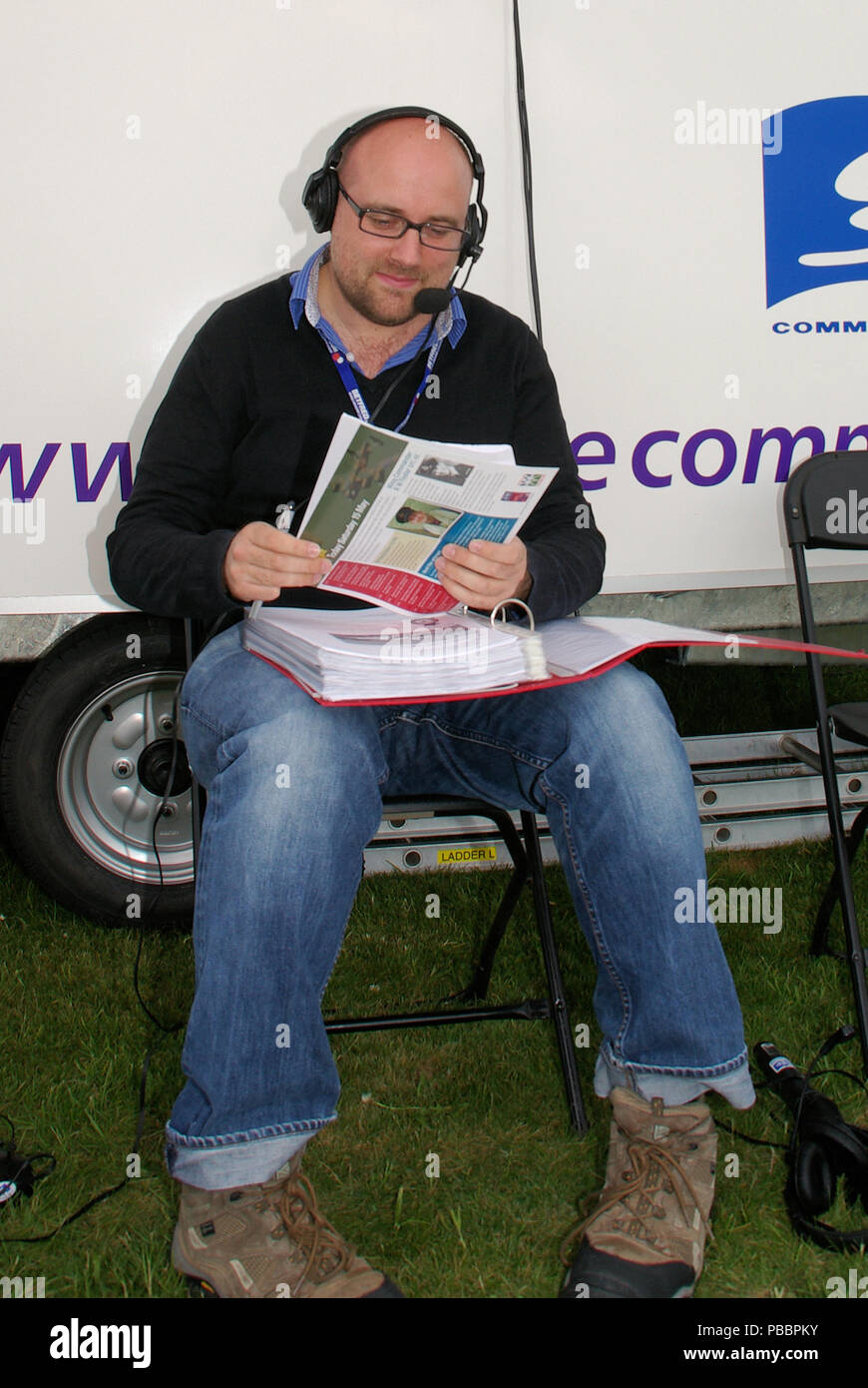 Ben Dunnell, aviation journalist and airshow commentator with notes. Air show - Stock Image