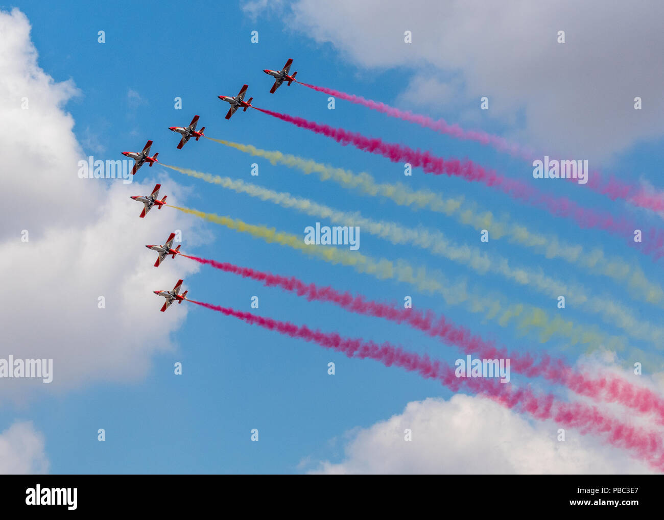 Patrulla Águila Spanish for 'Eagle Patrol aerobatics team in formation flying over RAF Fairford air tattoo. - Stock Image