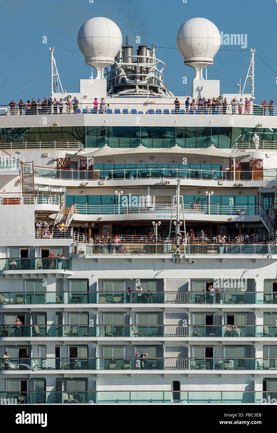 the p and o cruise liner azura leaving Southampton with passengers on deck and on their balconies. Stock Photo