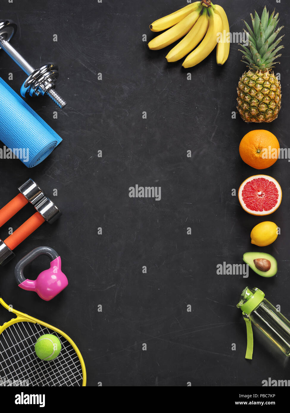 Sports equipment and organic food on black background. Top view. Motivation - Stock Image