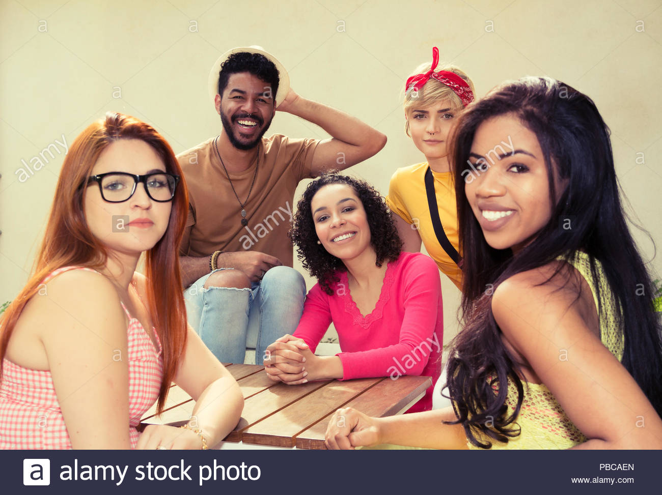 Portrait of Young adults having a great time at cafe bar outdoor. Multicultural students bonding at restaurant outside. Summer, warm, friendship, dive - Stock Image