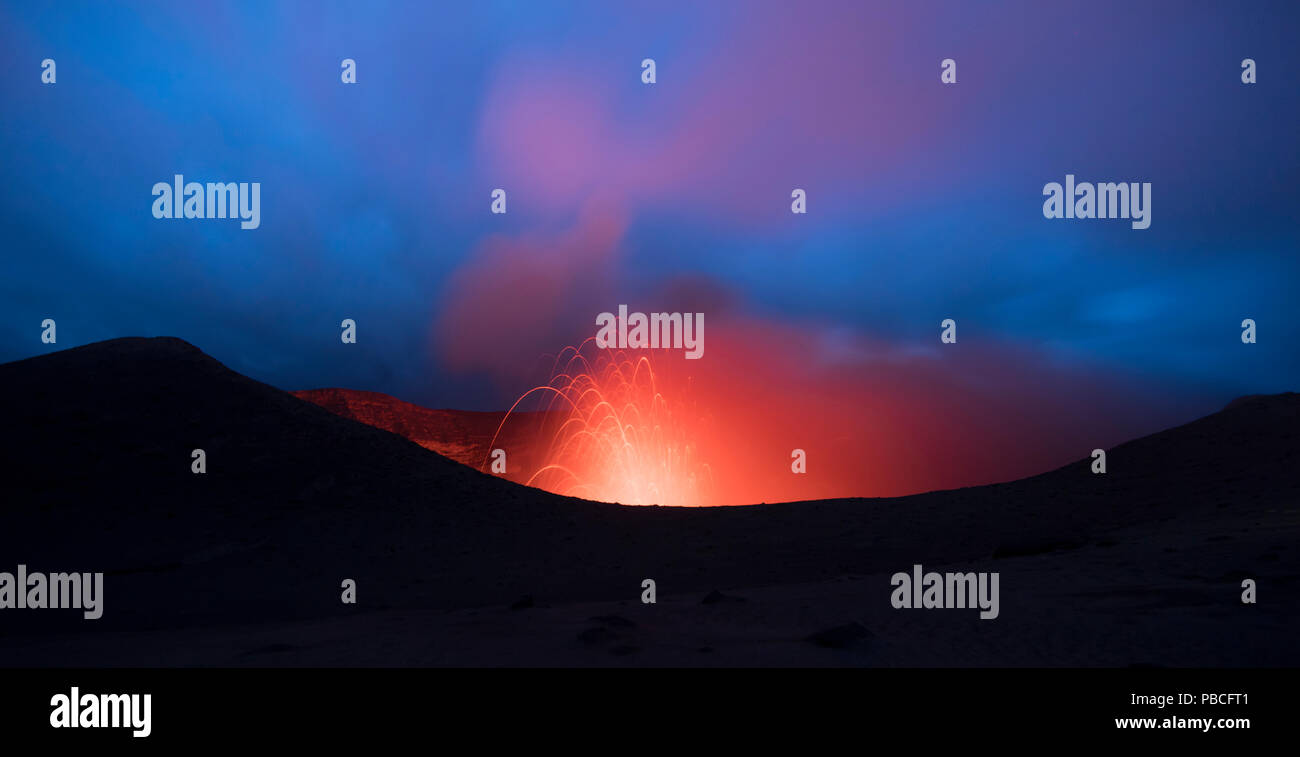 Volcanic Eruption with lava, from the crater edge at night - Mt Yasur, Tanna Island Stock Photo