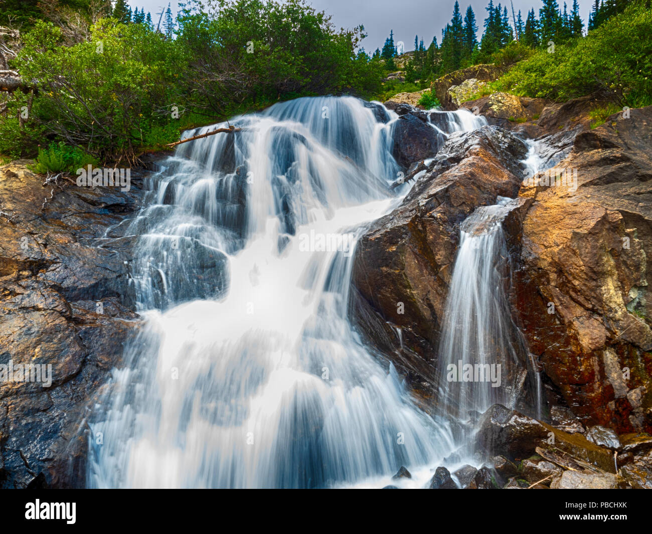 Waterfall in the Arapaho National Forrest Near Breckenridge Colorado on a Summer Day - Stock Image