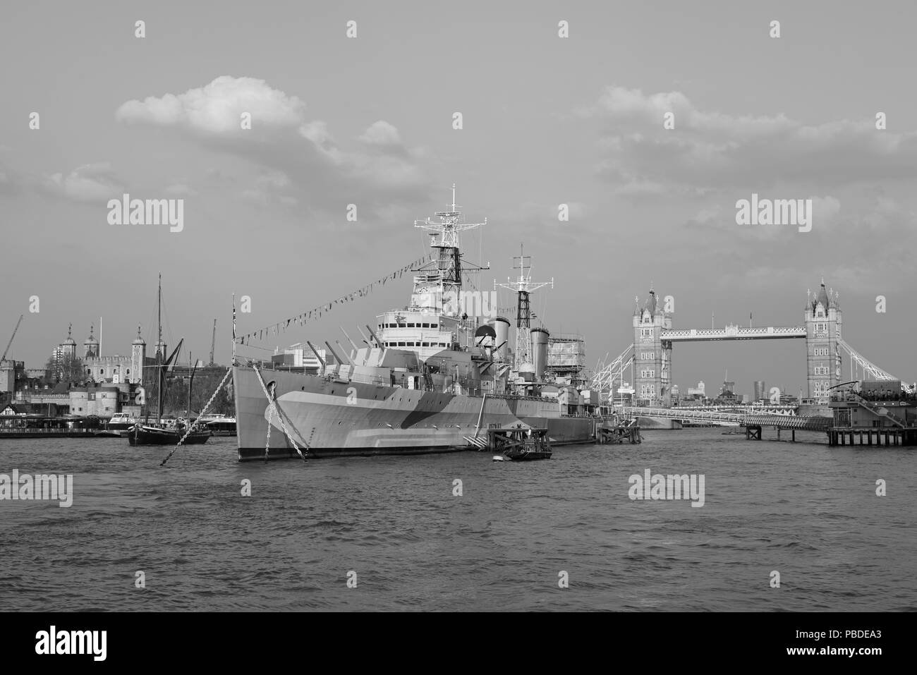 The Sailing Barge, Hydrogen, HMS Belfast, Tower of London and Tower Bridge, River Thames in London - Stock Image