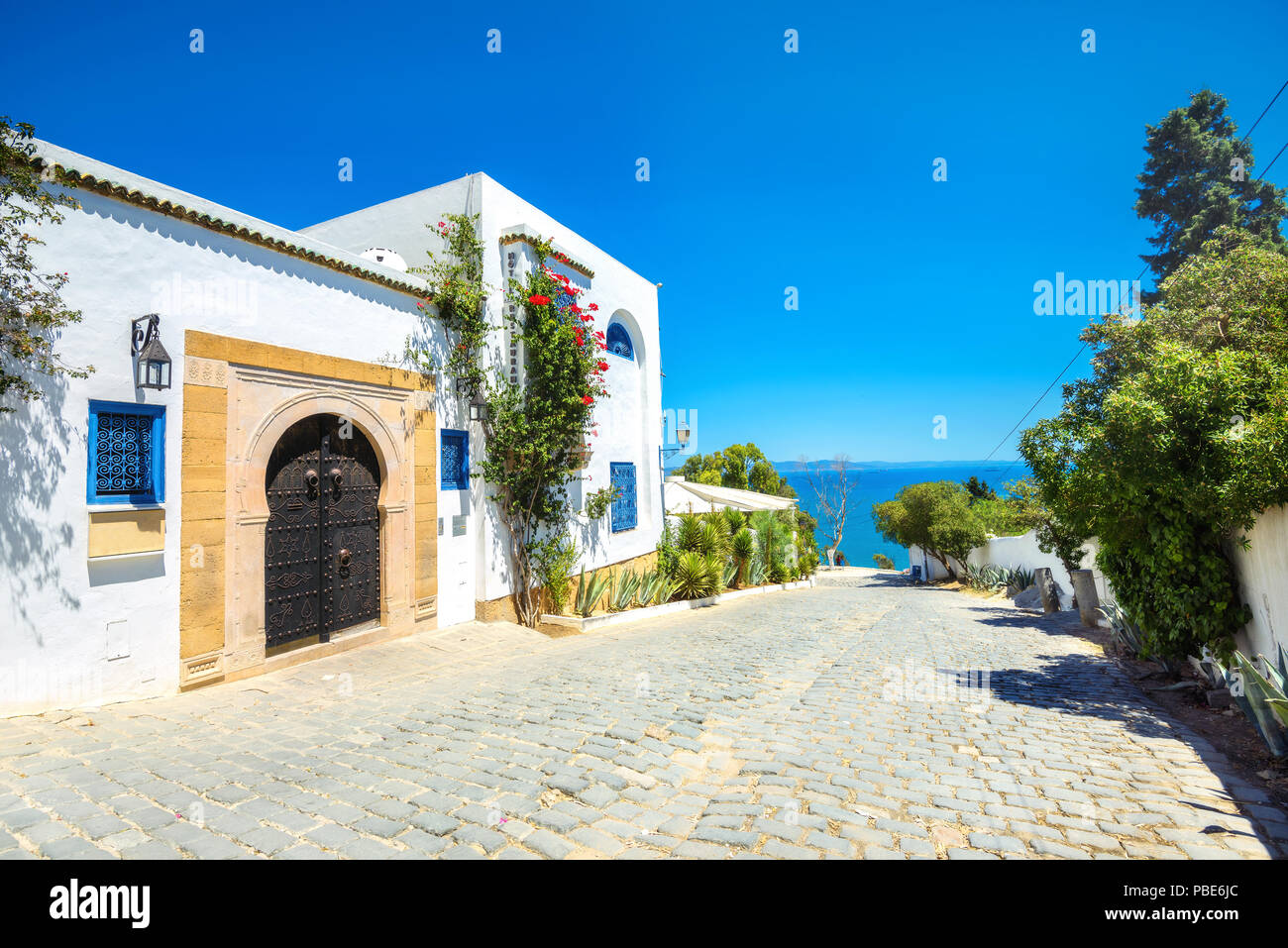 Street in white blue town Sidi Bou Said. Tunisia, North Africa - Stock Image