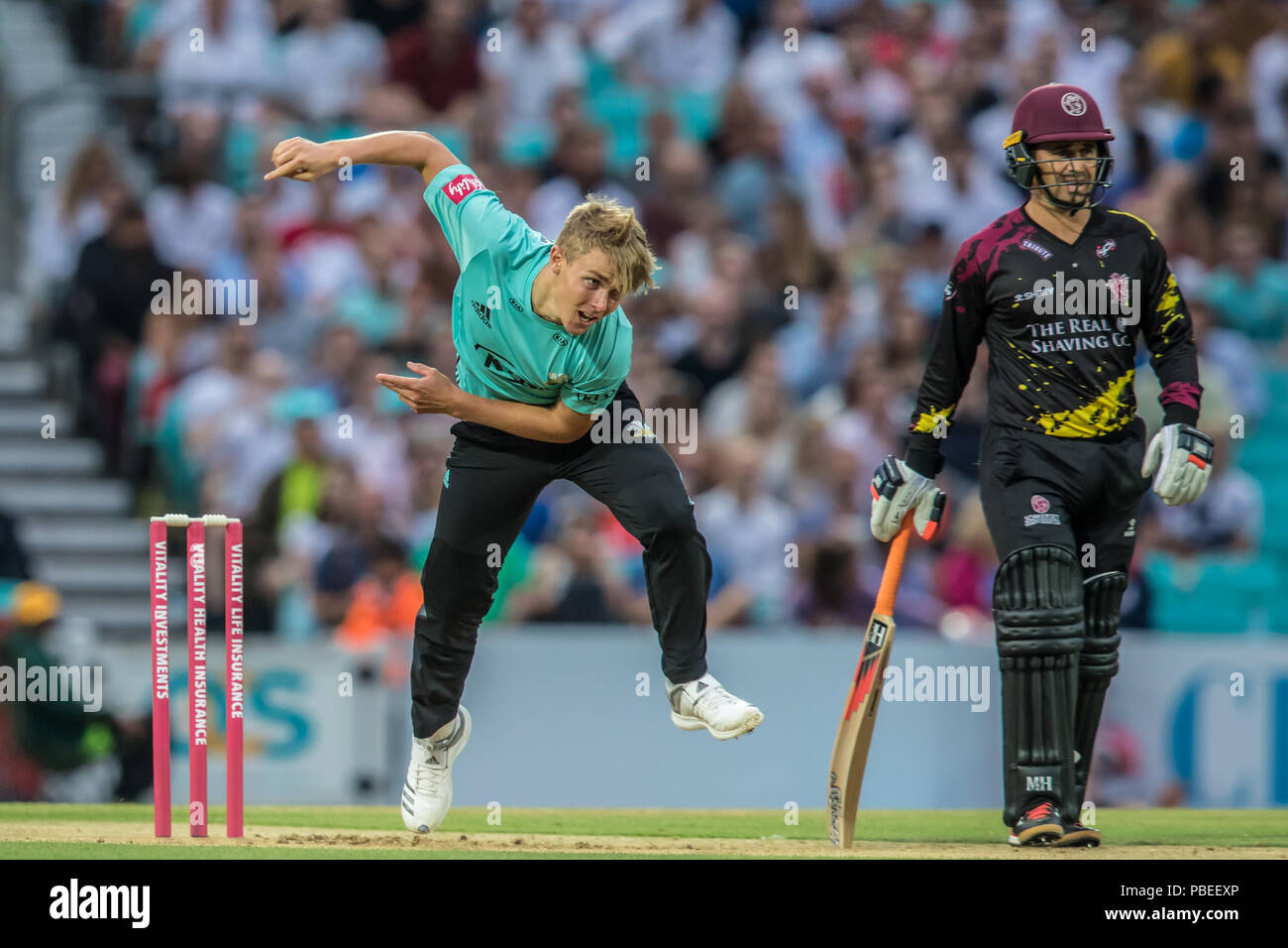 London, UK  27 July, 2018  Sam Curran bowling for Surrey against