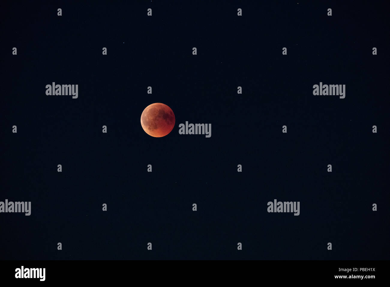 Düsseldorf, Germany. 27th July 2018. Moon Eclipse over Düsseldorf Credit: Jochen Brood/Alamy Live News - Stock Image