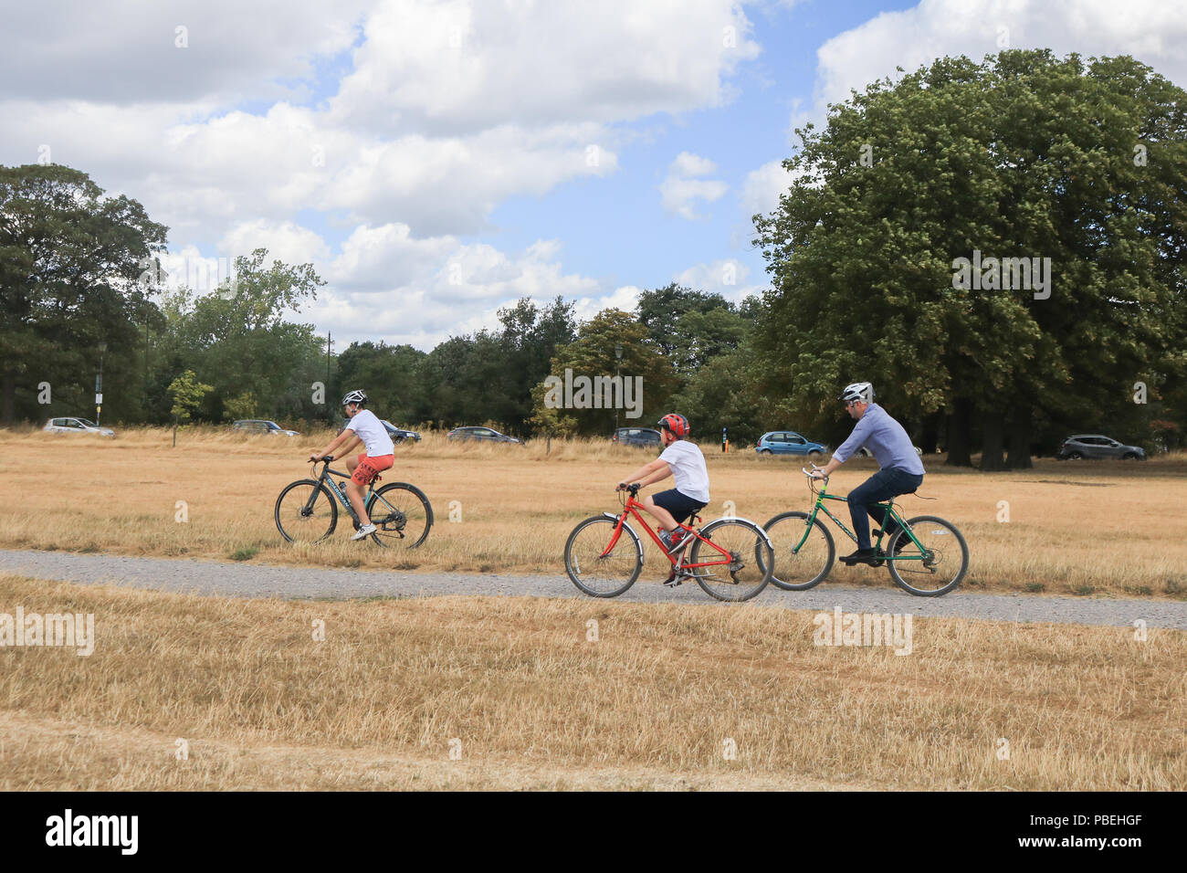 London UK. 28th July 2018. Cyclists ride  on  Wimbledon Common with cooler temperatures forecast for the weekend after the hottest July on Friday recorded Credit: amer ghazzal/Alamy Live News Stock Photo