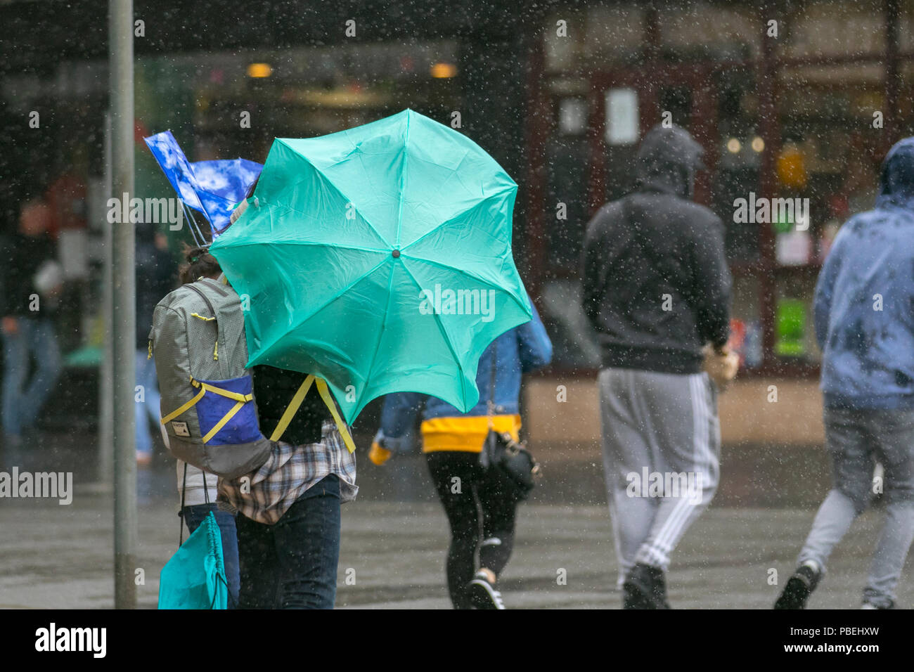 Blackpool, Lancashire, UK Weather. 28/07/2018. Heavy rain and strong winds at the coast with gales forecast for later in the day.  Credit: MediaWorldImages/AlamyLiveNews Stock Photo
