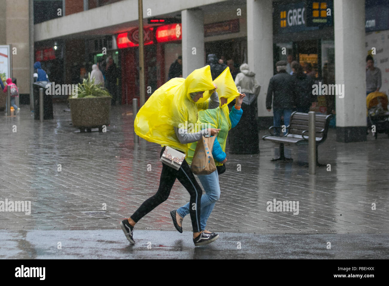 Blackpool, Lancashire, UK Weather. 28/07/2018. Heavy rain and strong winds at the coast with gales forecast for later in the day.  Credit: MediaWorldImages/AlamyLiveNews - Stock Image