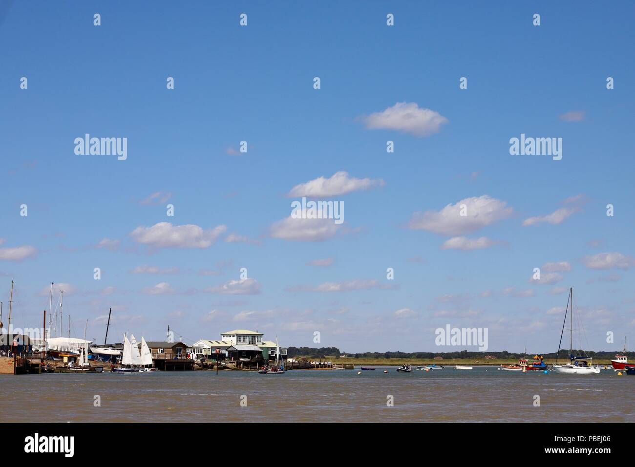 UK Weather: Bright warm and breezy this  morning for boats on the River Deben at Felixstowe Ferry, Suffolk. Credit: Angela Chalmers/Alamy Live News - Stock Image