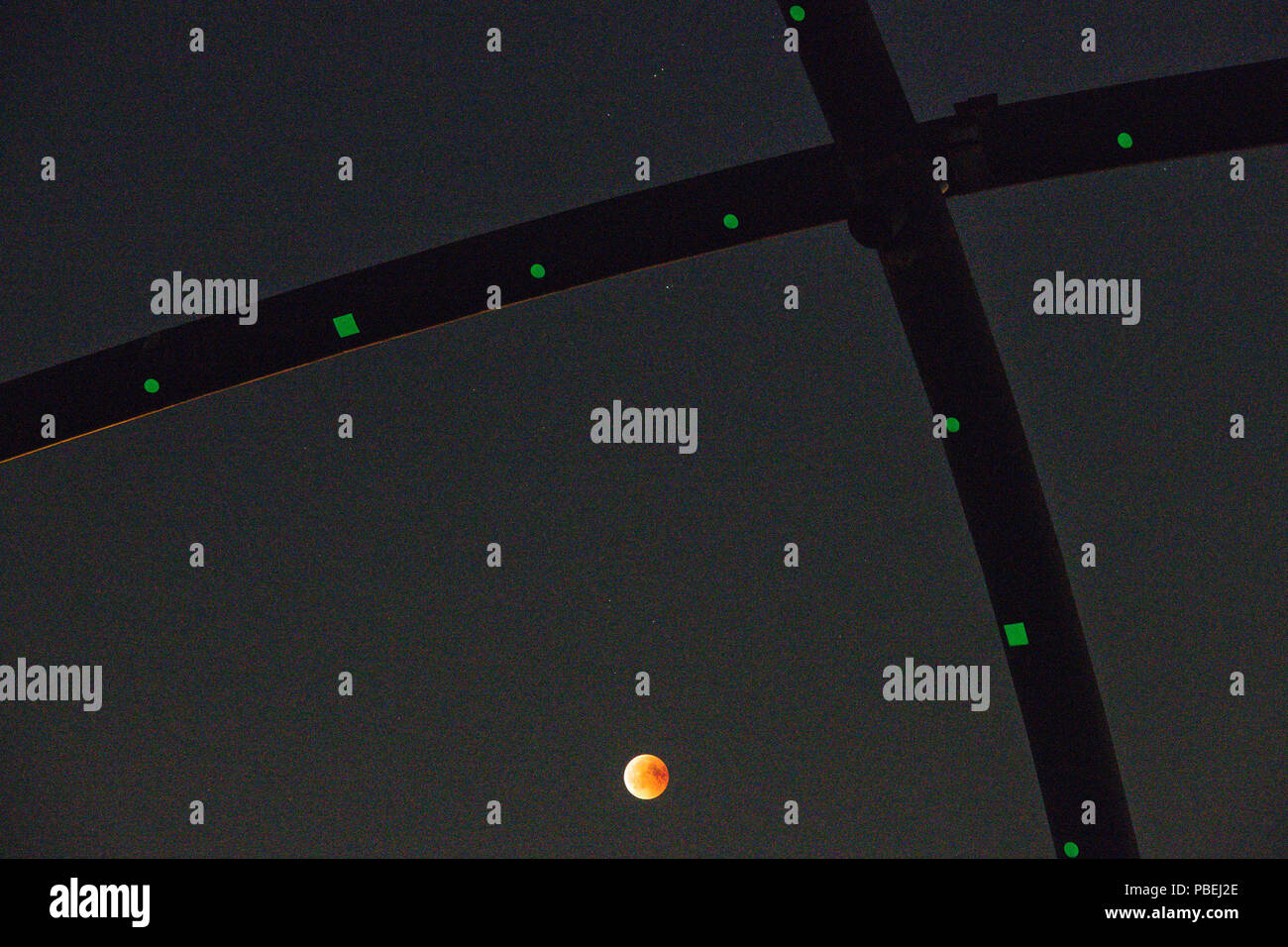 Recklinghausen, Germany. 27th July, 2018. Stargazers can follow the lunar eclipse on the Hoheward slagheap between Recklinghausen and Herne. On the one side the sun sets and on the other the moon rises. Credit: Jana Bauch/dpa/Alamy Live News Stock Photo