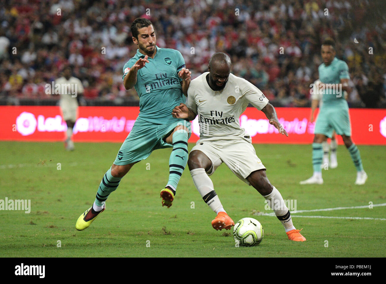 Singapore. 28th July, 2018. Arsenal's Henrikh Mkhitaryan (L) vies with Paris Saint-Germain's Lassana Diarra during the International Champions Cup soccer match held in Singapore on July 28, 2018. Credit: Then Chih Wey/Xinhua/Alamy Live News - Stock Image