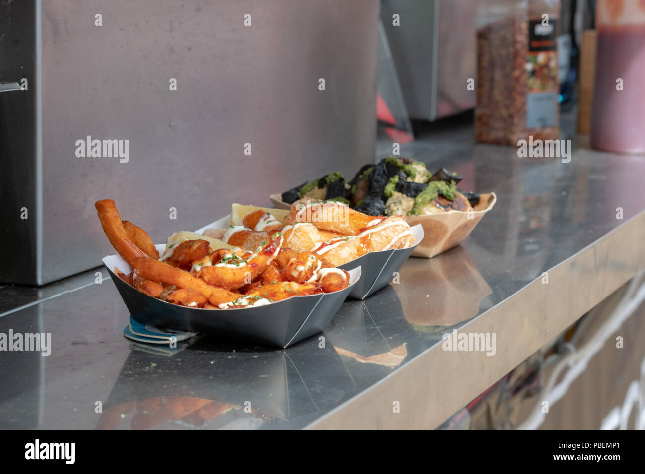 Poole, UK. 28th July 2018. Streetfood options at the Poole Harbour Festival in very windy weather. Credit: Thomas Faull/Alamy Live News Stock Photo