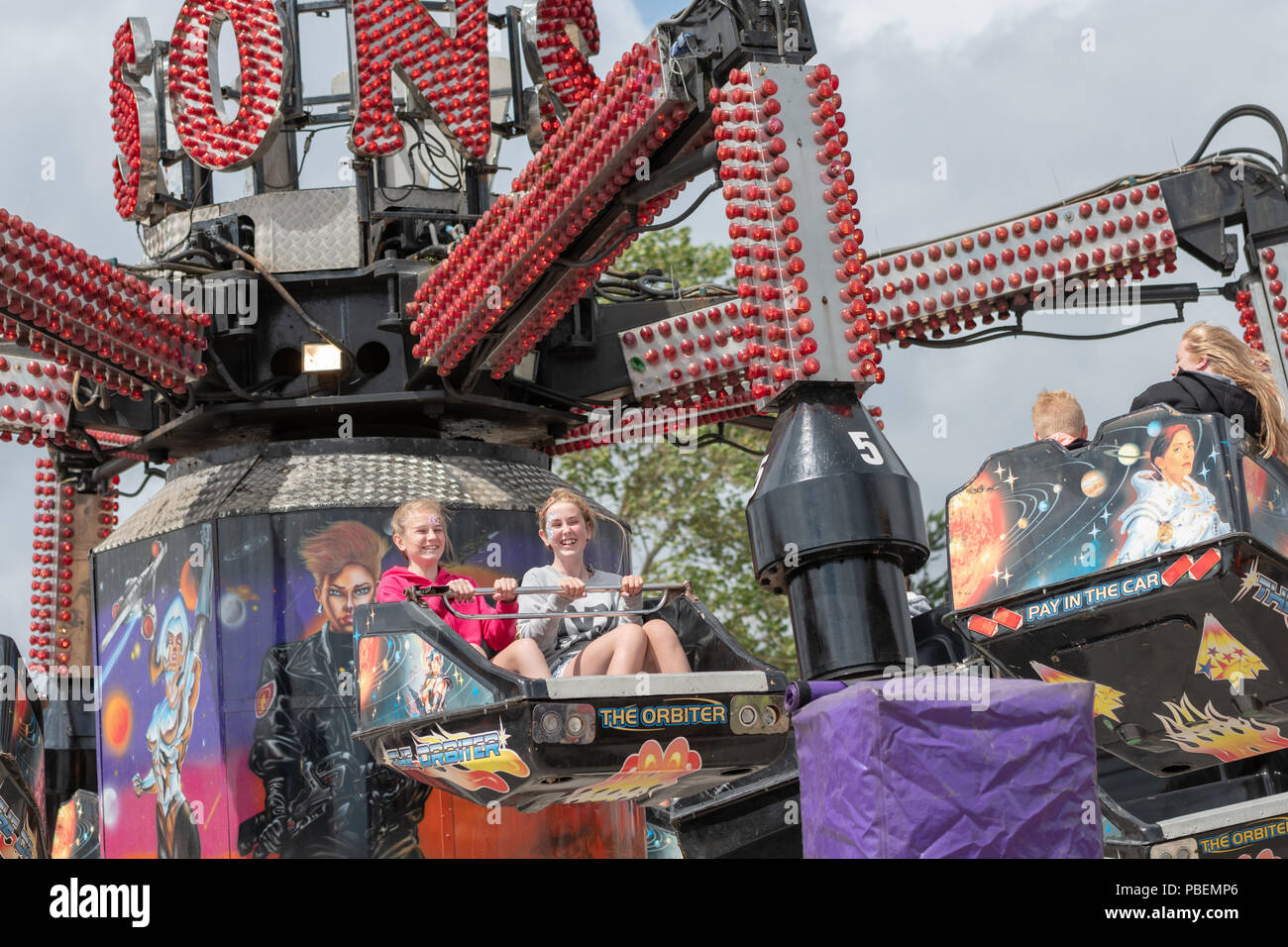 Poole, UK. 28th July 2018. People enjoy the rides, food stalls and live music at the Poole Harbour Festival in very windy weather. Credit: Thomas Faull/Alamy Live News Stock Photo