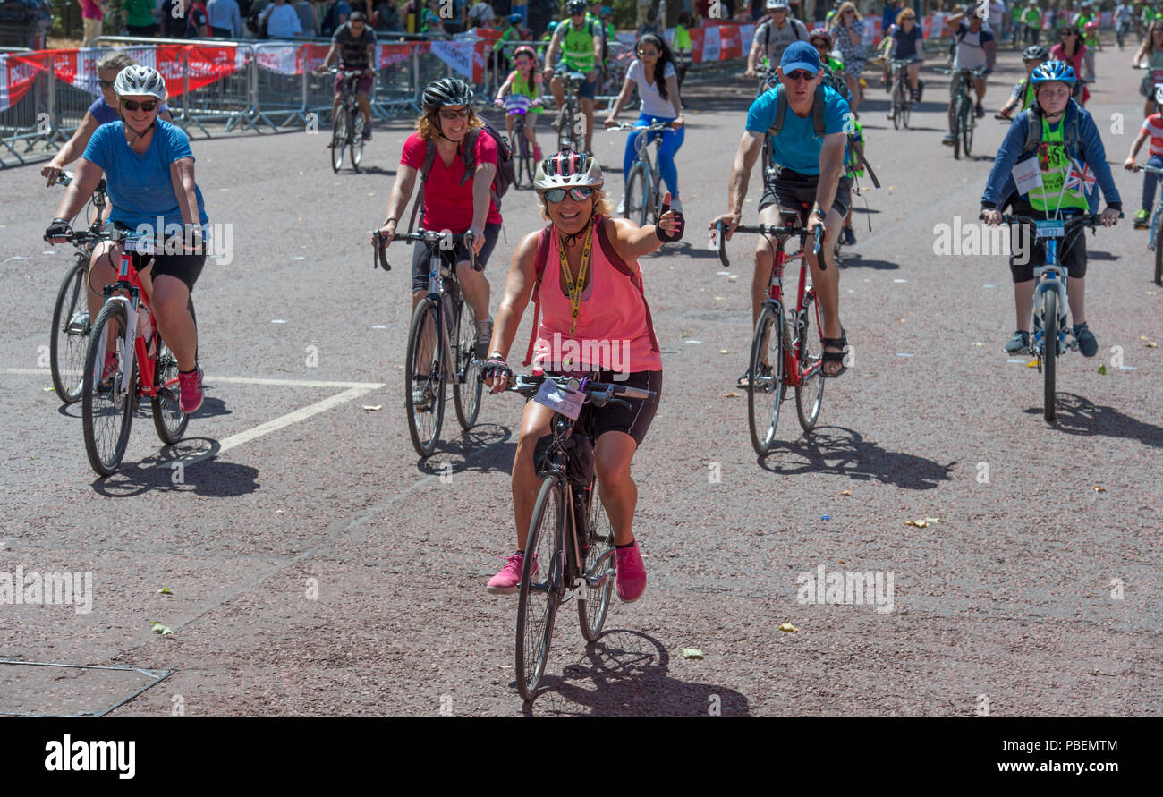 The Mall, London, UK. 28 July, 2018. The Prudential Ride London Freecycle gives everyone the chance to travel around the centre of London on a traffic free route of eight miles, joining the route at any point. Credit: Malcolm Park/Alamy Live News. Stock Photo