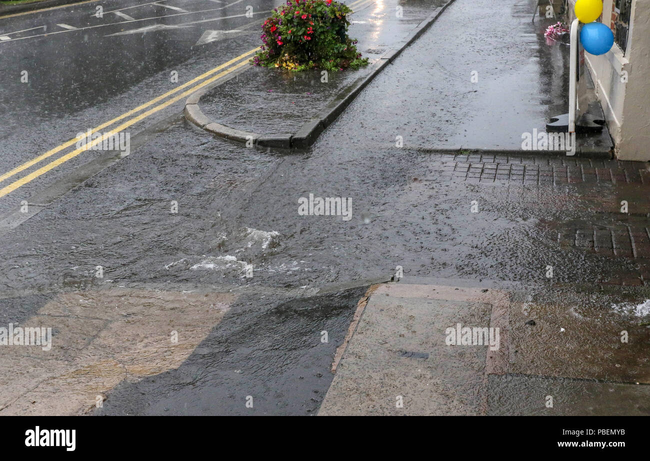 Moira, County Down, Northern Ireland. 28 July 2018. UK weather - torrential rain and thunder across Northern Ireland with a yellow warning for rain in place until 18.00 hrs, Drains were unable to cope with the heavy and sustained rain in Moira. Credit: David Hunter/Alamy Live News. - Stock Image