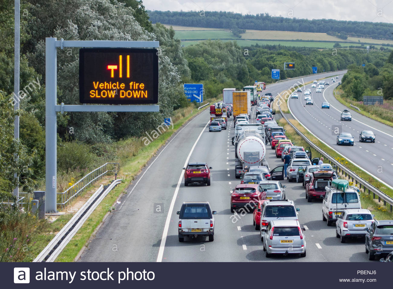 Carnforth, Lancashire, UK, 28th July 2018, stationary traffic on the M6 motorway southbound, between Junctions 36 and 35 just north of Carnforth following a vehicle fire and lane closure / lane closed - Stock Image