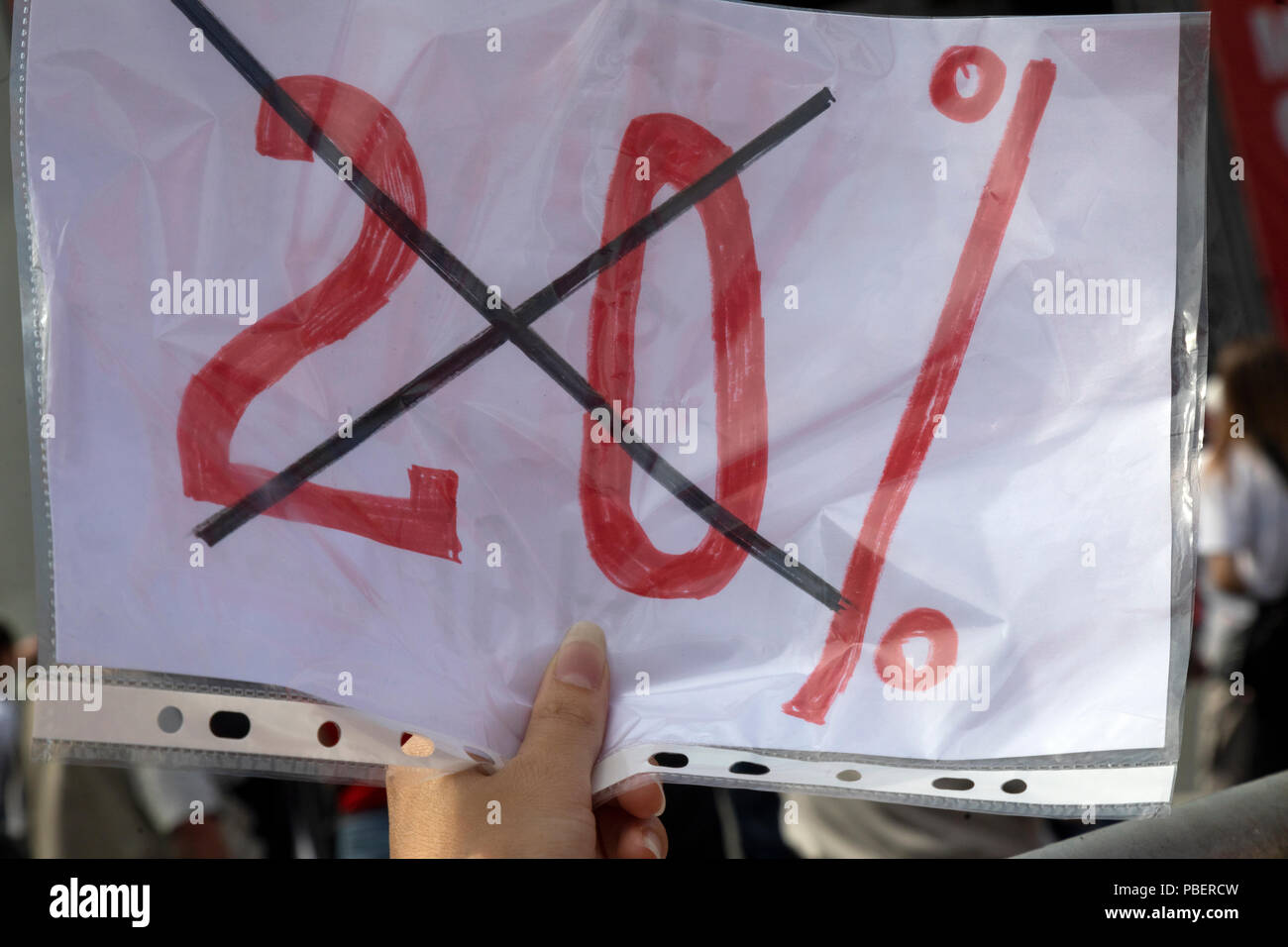 Moscow, Russia. 28th, July, 2018. Activist holds banner against raise the Value Added Tax (VAT) from 18 percent to 20 percent in Moscow, Russia - Stock Image