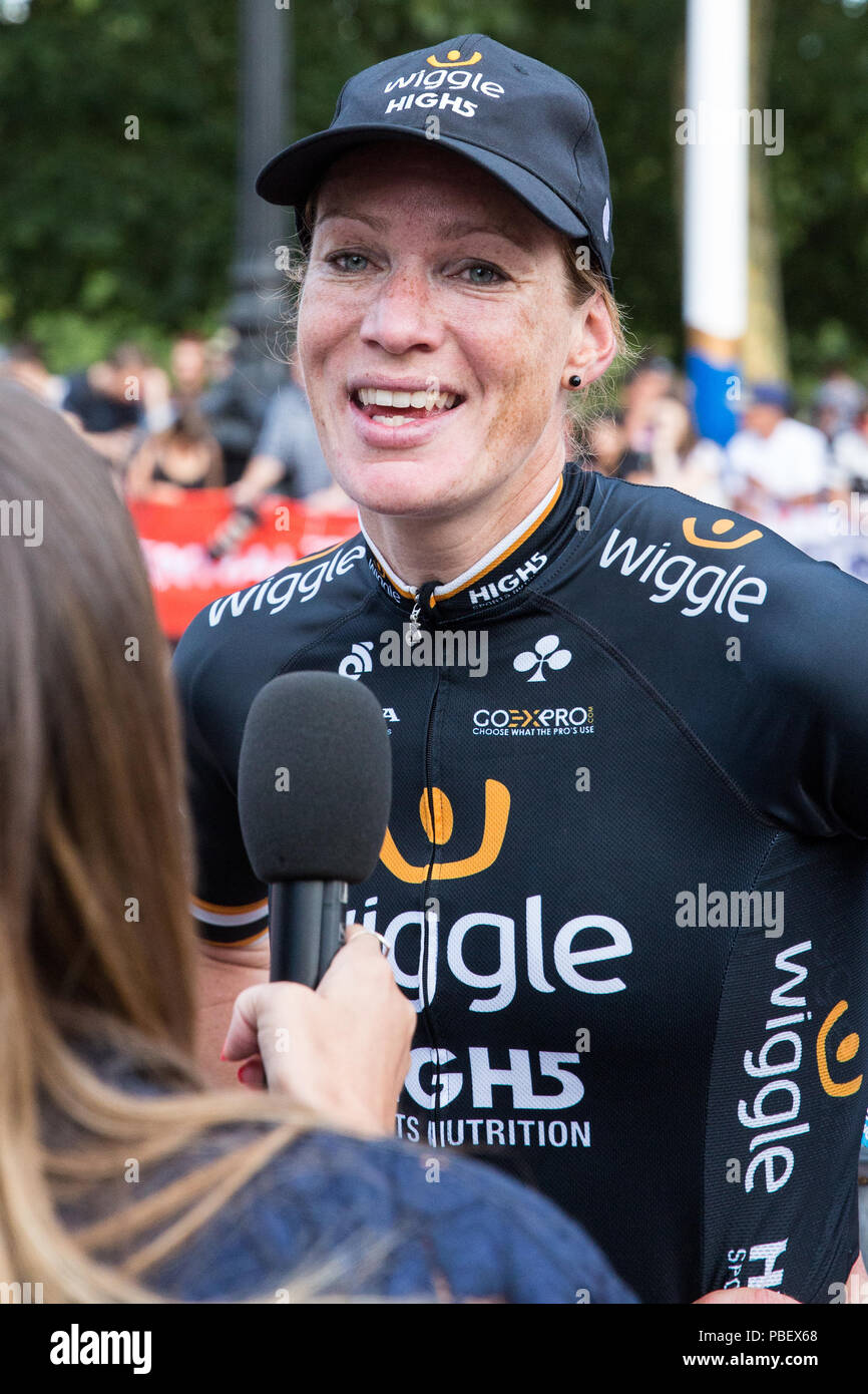 London, UK. 28th July, 2018. Kirsten Wild of the Wiggle High5 team is interviewed after winning the Prudential RideLondon Classique, the richest women's one-day race in cycling. The race is part of the UCI Women's World Tour and offers spectators the opportunity to see the world's best women's cycling teams battling it out over 12 laps of a closed 5.4km circuit starting and finishing on The Mall. Credit: Mark Kerrison/Alamy Live News Stock Photo