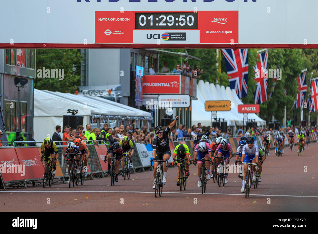 London, UK, 28 July 2018. Prudential RideLondon Classique. Kirsten Wild (Wiggle-High5, NED, centre) wins the bunch sprint at the RideLondon Classique - a 65km race around a 5.4km circuit finishing on The Mall. Wild beat Marianne Vos (Waowdeals, NED, right) and Elisa Balsamo (Valcar PBM, ITA, centre-right). Stock Photo