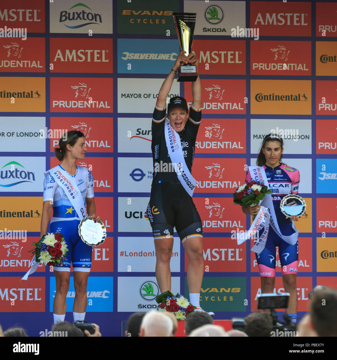 London, UK, 28 July 2018. Prudential RideLondon Classique. Kirsten Wild (Wiggle-High5, NED, first, centre), Marianne Vos (Waowdeals, NED, second, left) and Elisa Balsamo (Valcar PBM, ITA, third, right) share the podium at the RideLondon Classique - a 65km race around a 5.4km circuit finishing on The Mall. Stock Photo