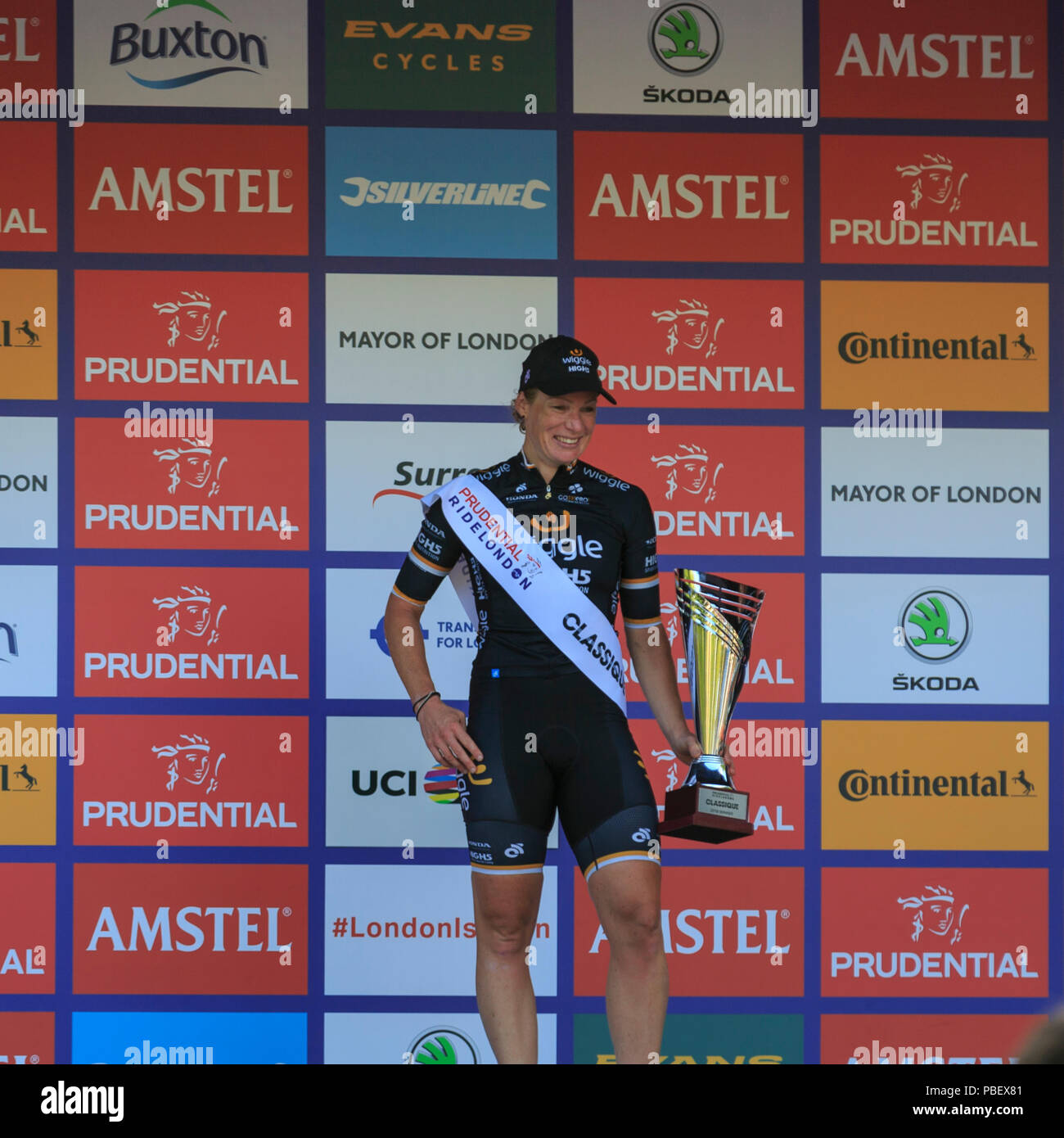 London, UK, 28 July 2018. Prudential RideLondon Classique. Kirsten Wild (Wiggle-High5, NED) stands on the podium after winning the RideLondon Classique - a 65km race around a 5.4km circuit finishing on The Mall. Stock Photo