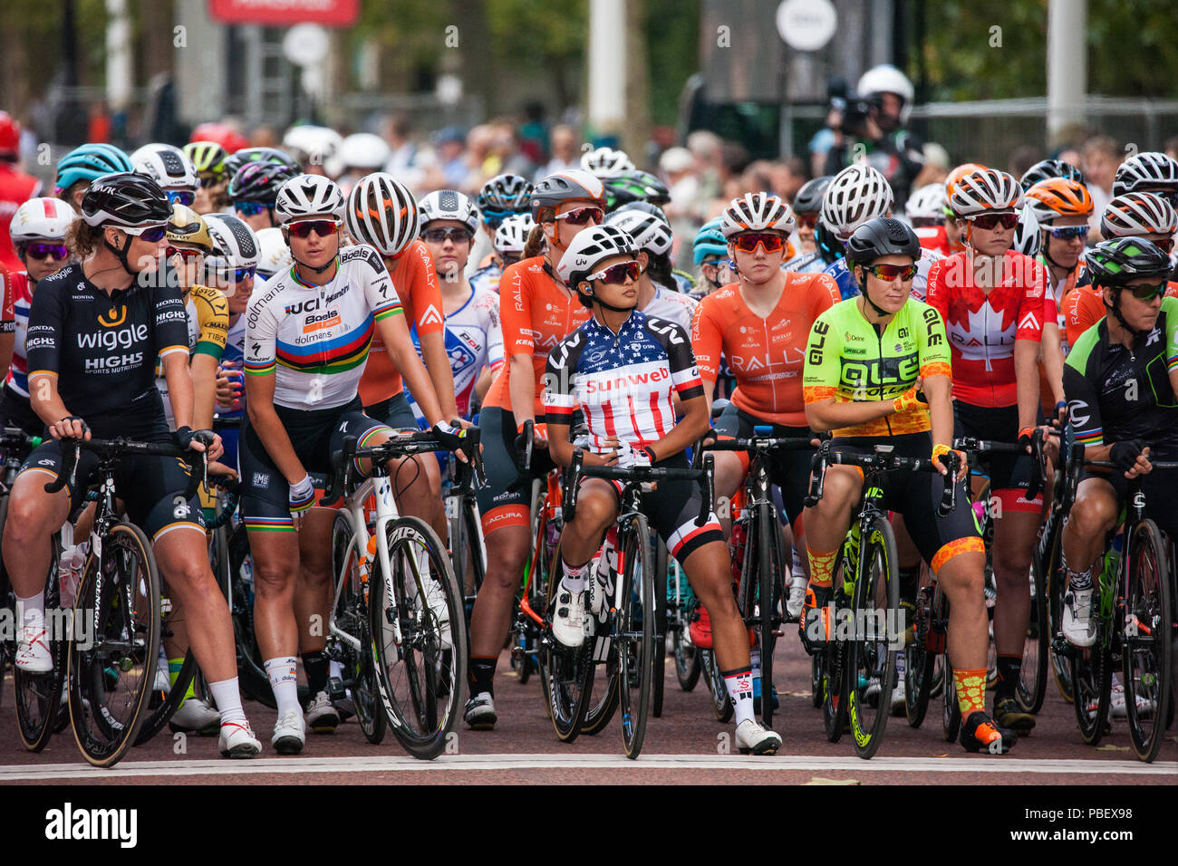London, UK. 28th July, 2018. Elite women riders, including eventual race winner Kirsten Wild (l) of the Wiggle High5 team, prepare to compete in the Prudential RideLondon Classique, the richest women's one-day race in cycling. The race is part of the UCI Women's World Tour and offers spectators the opportunity to see the world's best women's cycling teams battling it out over 12 laps of a closed 5.4km circuit starting and finishing on The Mall. Credit: Mark Kerrison/Alamy Live News Stock Photo