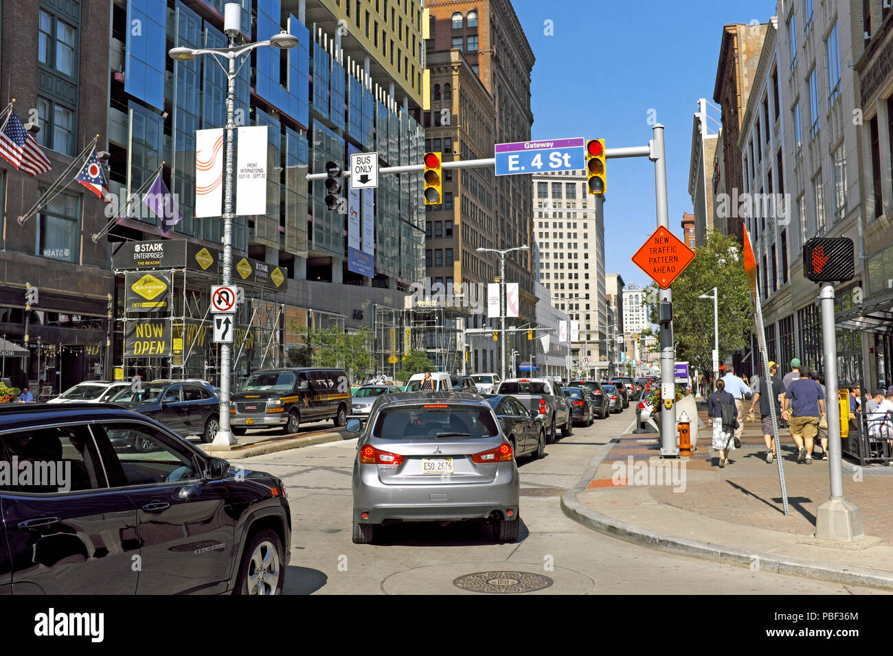 Busy downtown Cleveland, Ohio at the intersection of the pedestrian-only East 4th Street and the traffic-clogged Euclid Avenue corridor. - Stock Image