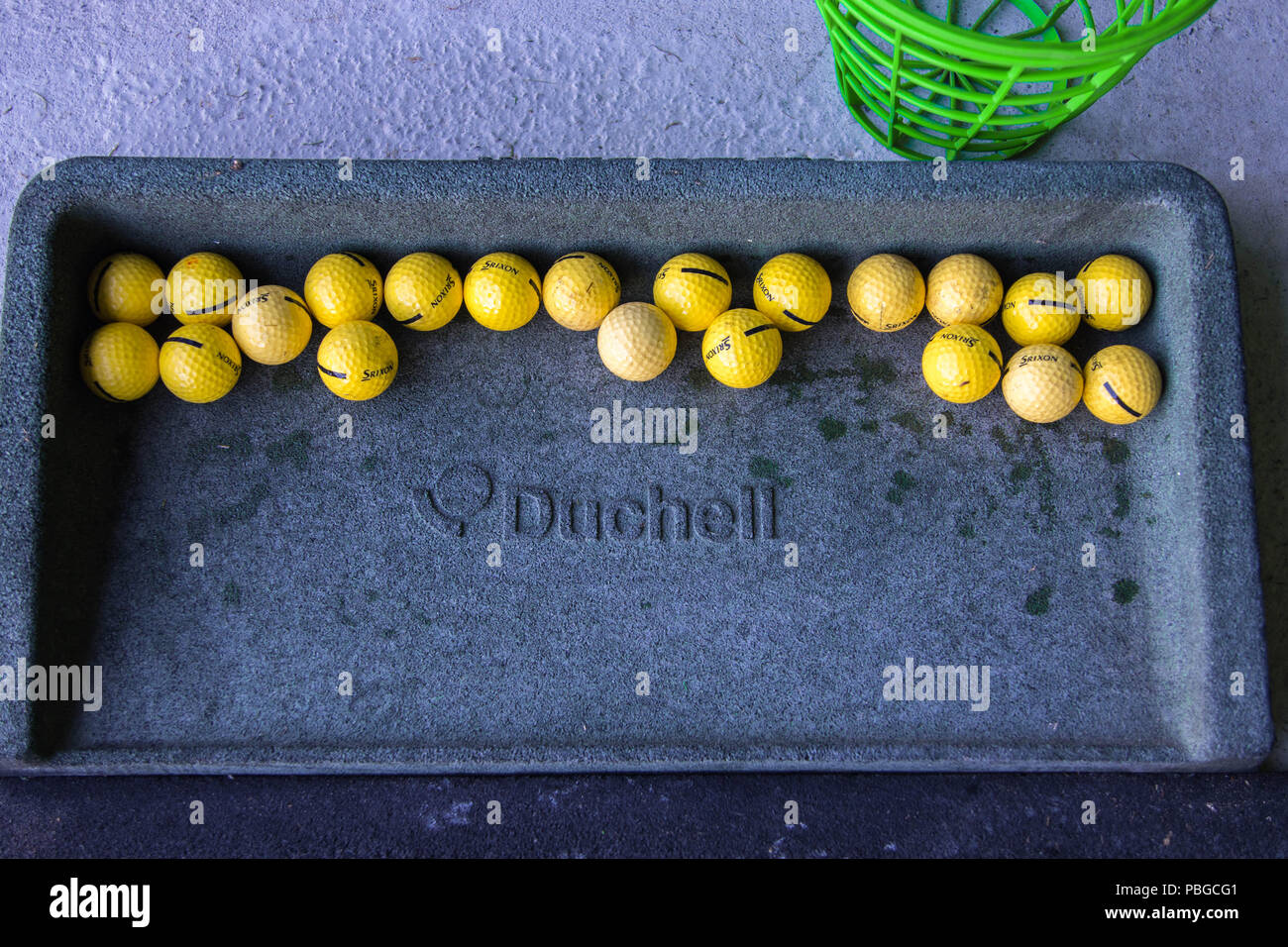 Duchell golf ball tray with srixon yellow golf ball - Stock Image