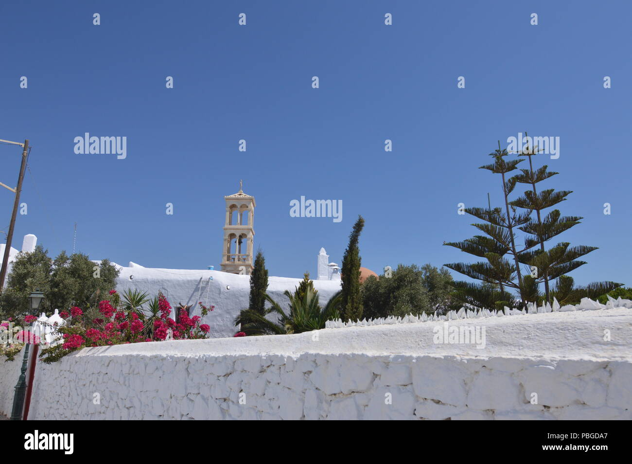 Courtyard And Bell Tower Of Panagia Tourliani Monastery In Ano Mera On The Island Of Mykonos. Architecture Landscapes Travels Cruises. July 3, 2018. A Stock Photo
