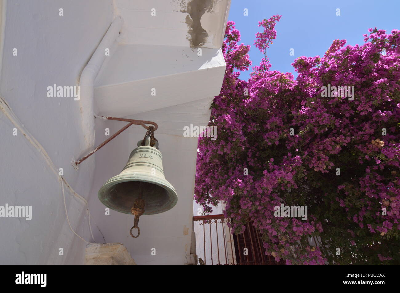 Bell Of The Panagia Tourliani Monastery In Ano Mera On The Island Of Mykonos. Architecture Landscapes Travels Cruises. July 3, 2018. Ano Mera, Island  Stock Photo