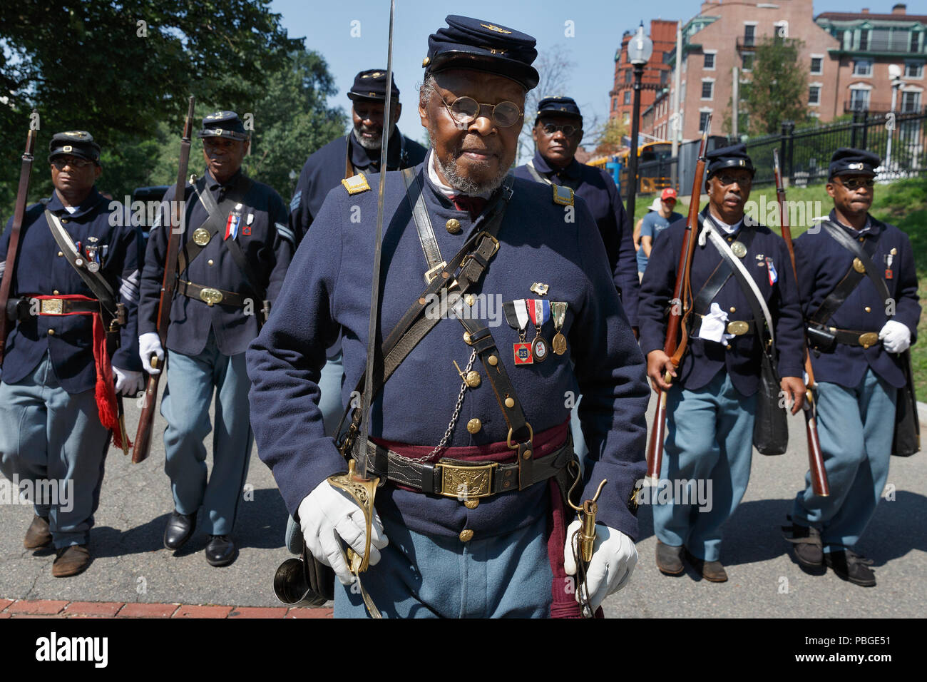 American Civil War re-enactors from Massachusetts 54th Infantry Regiment in front of the Shaw 54th memorial on Boston Common Boston Massachusetts USA - Stock Image