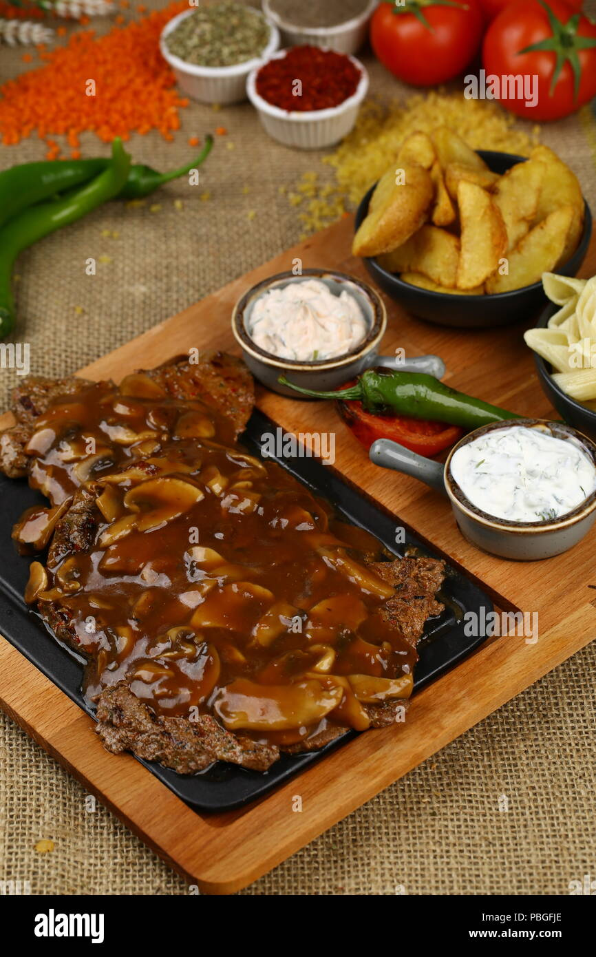 Grilled Beef Meat Steak with Barbeque Sauce - Stock Image